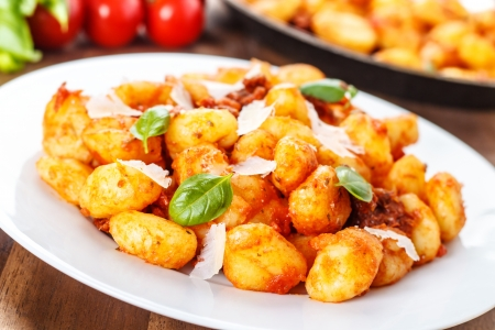 fresh italian gnocchi with tomato sauce and parmesan cheese Stock Photo