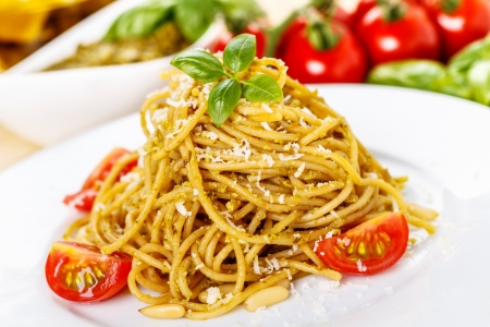 fresh spaghetti with basil pesto and parmesan cheese