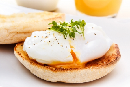poached egg on english muffin with watercress