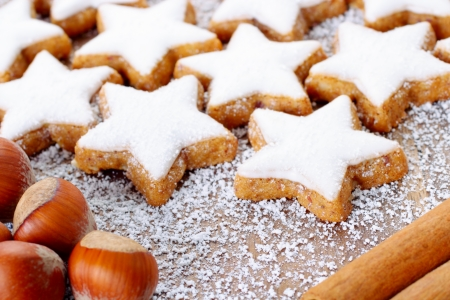 backing: fresh cinnamon star shaped cookies with frosting Stock Photo