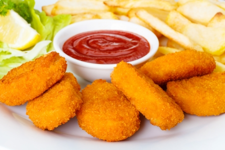 Chicken nuggets with french fries and ketchup Foto de archivo