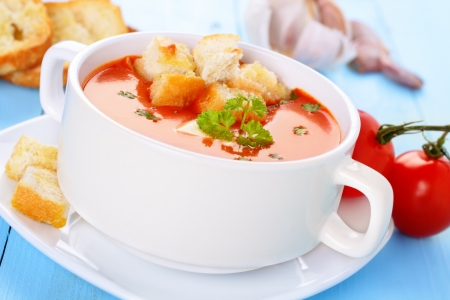 fresh tomato soup with herbs and homemade croutons Stock Photo