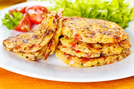 fresh homemade vegetable fritters with zucchini, paprika and corn Foto de archivo