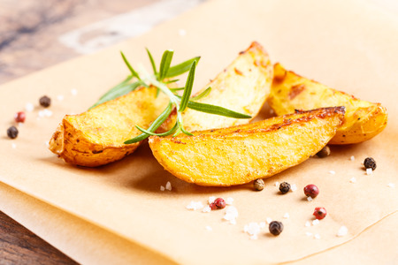 potato wedges: tasty fried potato slices with herbs