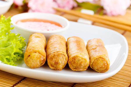 fresh spring rolls with vegetables on chinnese dishware.