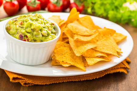 fresh homemade hot guacamole with tortilla chips