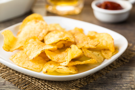 Hearty potato chips served on a plate Stock Photo