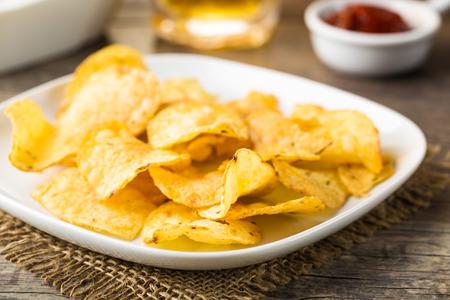 potato crisps: Hearty potato chips served on a plate Stock Photo