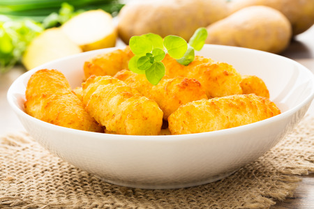 crunchy: crunchy homemade potato croquettes served in a bowl.