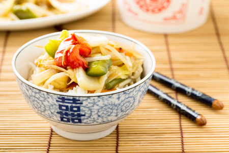 beansprouts: rice with sweet and sour vegetables in chinese dishware.