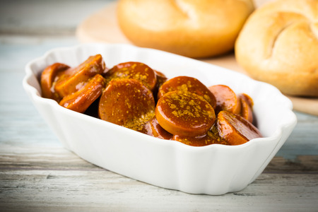 smoked sausage: german currywurst - pieces of curried sausage