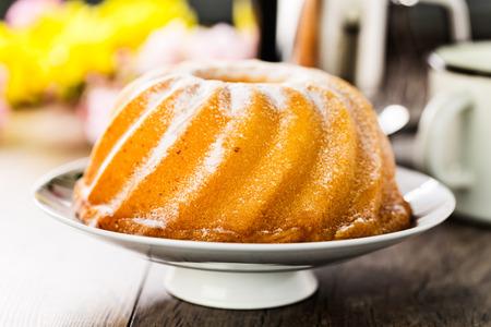 homemade lemon bundt cake with icing sugar. Stock Photo