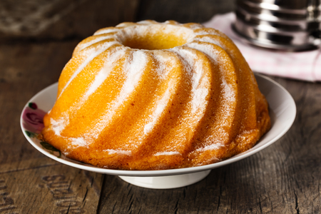 homemade lemon bundt cake with icing sugar. Stock Photo