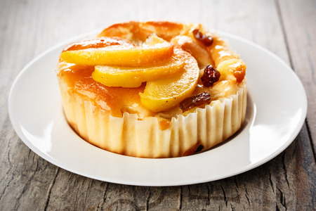 caramelized: homemade mini apple cake with caramelized apple wedges and raisins.