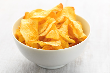 Hearty potato crisps served in a bowl.