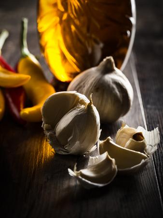 olio: still life aglio, olio e peperoncino with dramatic light. Stock Photo