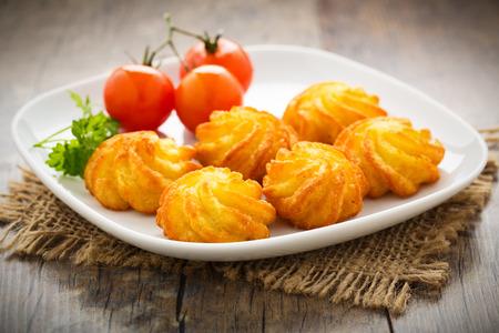crunchy: crunchy homemade pommes duchesse server on a plate