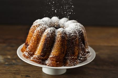 icing sugar: homemade bundt cake with icing sugar.