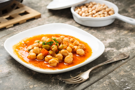 chick pea: tasty mediterranean chick pea salad with red onions, carrots and olives.