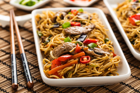 Lo mein with vegetables, mushrooms and soy filets.