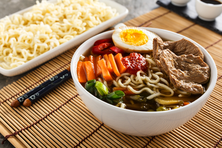 Shoyu ramen noodle soup with veggies, ginger and soy meat. Stock Photo