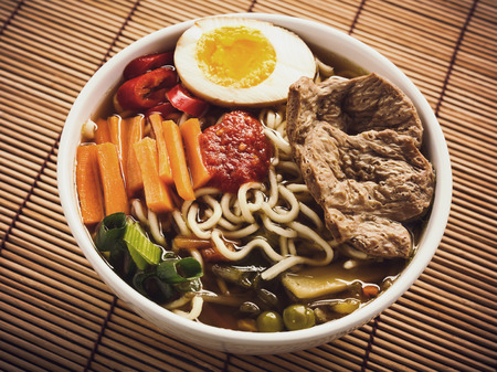 mie noodles: Shoyu ramen noodle soup with veggies, ginger and soy meat. Stock Photo