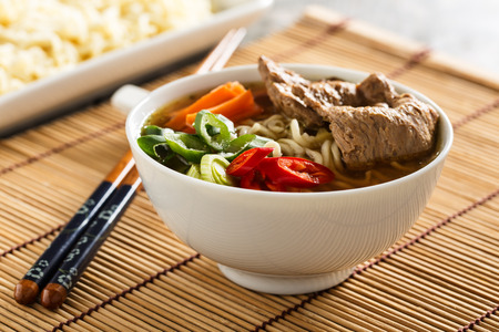 Shoyu ramen noodle soup with veggies, ginger and soy meat. 写真素材