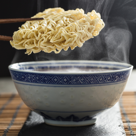mie noodles: Asian instant noodles over a traditional bowl and steam.