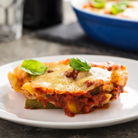 Fresh meatless italian pasta bake with vegetables and basil.