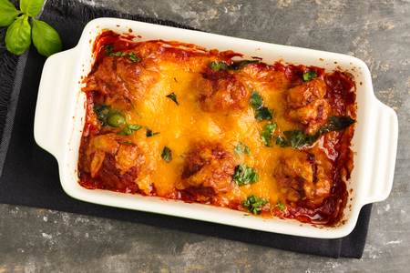 Homemade meatballs au gratin with mozzarella, parmesan and cheddar cheese. Stock Photo - 75301822