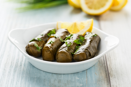Tasty stuffed vine leaves with lemon and herbs Banco de Imagens