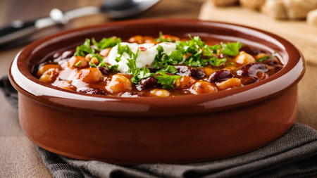 Hot stew with chick peas beans,  soy meat and chili peppers Standard-Bild - 99947256