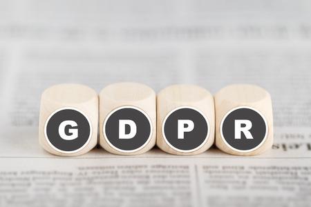 The phrase GDPR on cubes on newspaper. GDPR: General Data Protection Regulation Standard-Bild - 102891183