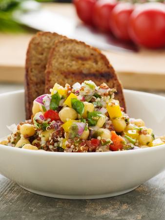 Vegan quinoa salad with chickpeas Standard-Bild - 111759614