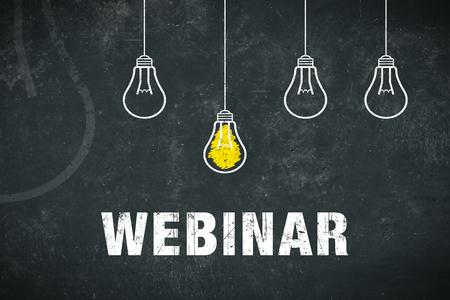 Graphic: webinar. Light bulbs on a chalkboard. Standard-Bild - 104882498