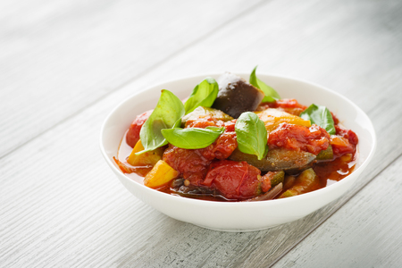 Ratatouille - french vegetable stew with tomotoes, aubergines, courgettes and peppers. Standard-Bild - 111759630