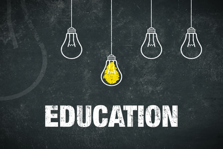 Banner Education - text and lightbulbs on a chalkboard Standard-Bild - 111759650
