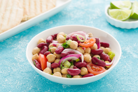 Tasty bean salad with chick peas, kidney beans and tomatoes.