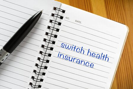 Notepad with note on it: switch health insurance