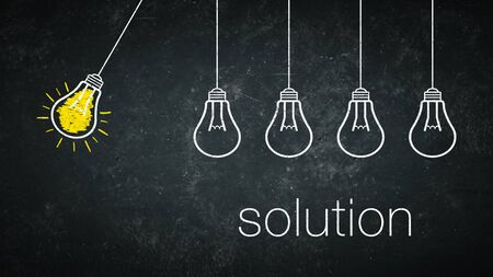 Graphic: solution - light bulbs and text on a chalkboard