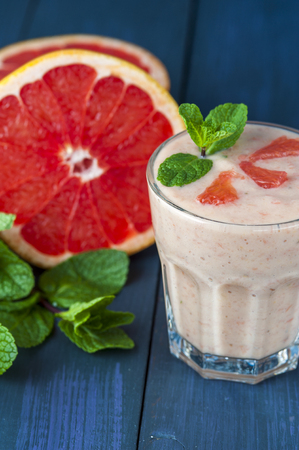 nonalcoholic: Glass of homemade smoothie with grapefruit, banana and mint leaves . Conception of healthy food.  Nonalcoholic drinks.