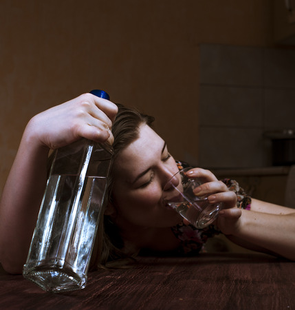 alcoholic drink: Drunk woman holding bottle and drinking her alcoholic drink. Female alcoholism.