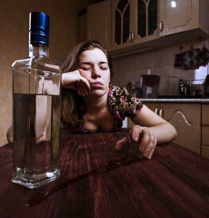 drunk girl: Drunk woman falling asleep with glass of alcoholic drink. Selective focus.