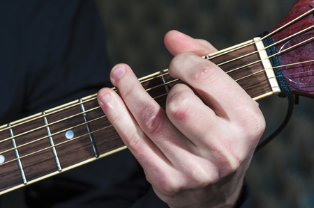 hand jamming: Closeup of mans hand playing on acoustic guitar Stock Photo