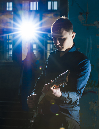 hand jamming: Portrait of yong guitarist playing on electric guitar
