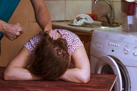 beating: Aggression in the family: man beating up his wife. Domestic violence.