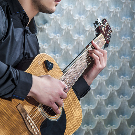 hand jamming: Man playing on acoustic guitar, closeup. Stock Photo