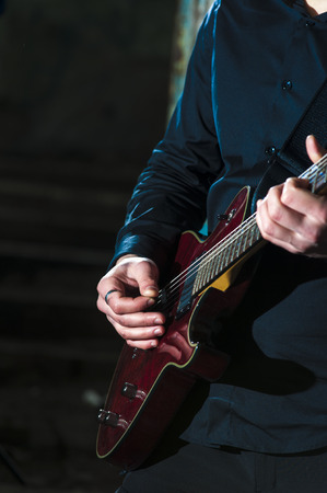 hand jamming: Closeup of mans hands playing on electric  guitar