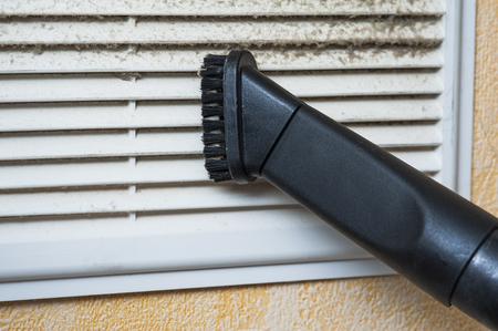 Closeup of vacuum cleaner pipe and ventilation grill Standard-Bild