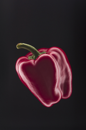 pimiento: Red bell pepper on black background Stock Photo
